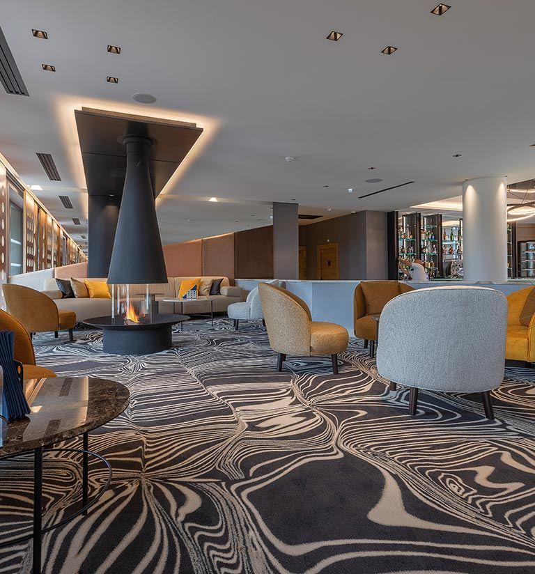 Coin cheminée Le Ricochet - Hotel Rivage | MGM Hôtels & Résidences